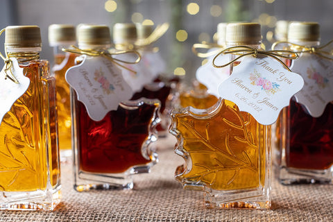 Hang Tags by Karla Brown Designs from Etsy displayed on maple syrup wedding favors.