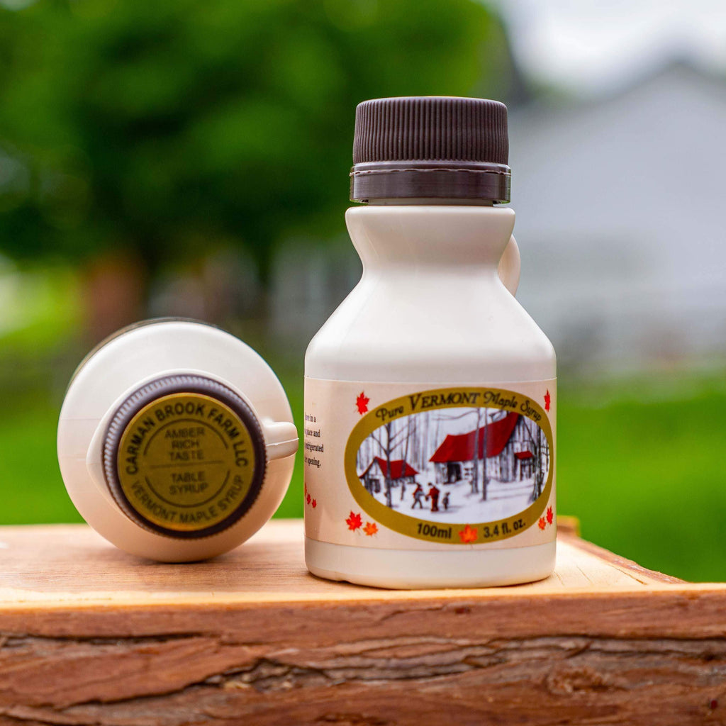 Edible wedding favors are 3.4 ounces of pure Vermont maple syrup in a cute jug.