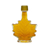 A maple leaf shaped bottle of maple syrup for a wedding favor.