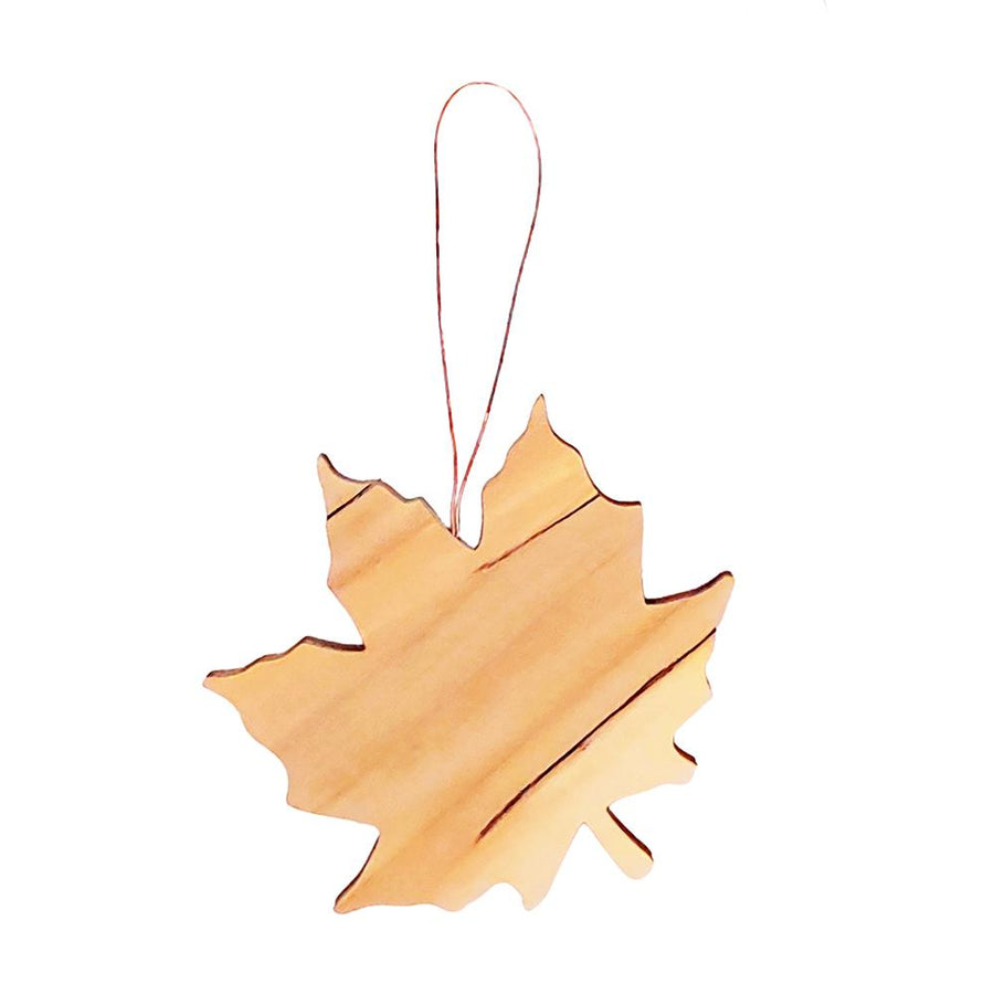 Spalted maple leaf ornament with copper wire hanger.