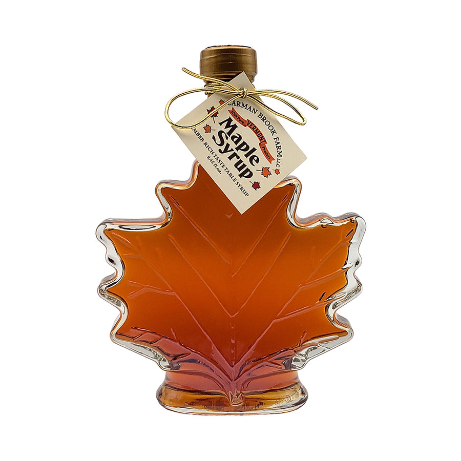 Our maple leaf shaped bottle filled with amber rich taste grade of syrup.