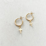 "Keep your faith close wherever you go.  Cross Huggie Hoop Earrings are classy, dainty and perfect size for everyday wear.   Each cross charm is carefully handmade with 14k Gold Filled.     14K Gold Filled  Cross size: 7mm x 6mm (0.27"" x 0.23"")  Hoop size: 13mm (1/2"") in diameter"