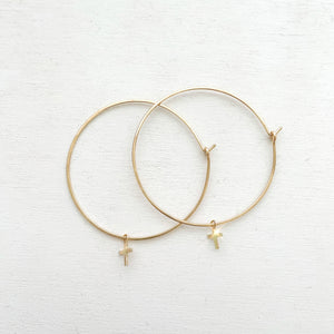 "Keep your faith close wherever you go.  These lightweight Cross Hoop Earrings are large yet so dainty with removable mini cross charms.  Each cross charm is carefully handmade with 14k Gold Filled.     14K Gold Filled  Cross size: 7mm x 6mm (0.27"" x 0.23"")  Hoop size: 50mm (2"") in diameter Keep your faith close wherever you go.  These lightweight Cross Hoop Earrings are large yet so dainty with removable mini cross charms.  Each cross charm is carefully handmade with 14k Gold Filled.     14K Gold Filled  Cr"