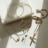 "Keep your faith close wherever you go.  These lightweight Cross Hoop Earrings are large yet so dainty with removable mini cross charms.  Each cross charm is carefully handmade with 14k Gold Filled.     14K Gold Filled  Cross size: 7mm x 6mm (0.27"" x 0.23"")  Hoop size: 50mm (2"") in diameter"