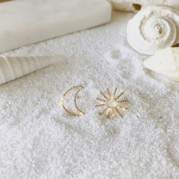LIVE BY THE SUN, LOVE BY THE MOON. ONE CANNOT EXIST WITHOUT THE OTHER.  Make a statement with this asymmetric SUN and MOON studs.  This is definitely a go-to studs that fit in any style.  Materials  14K Gold Filled  Size  1/2