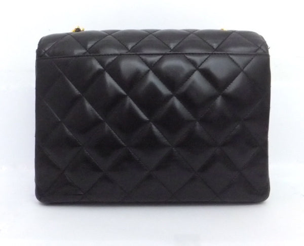 Authentic Chanel Vintage Black Labmskin Flapover