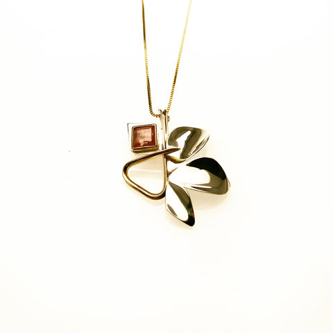 gold and silver leaf necklace with square pink tourmaline