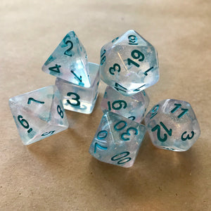 Winter Walker: 7 Piece Polyhedral Luminous Dice Set (Clear & Blue) - Miniature Town