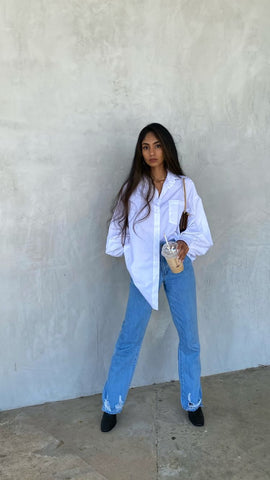 Shoulder bag styled with jeans and oversized button up