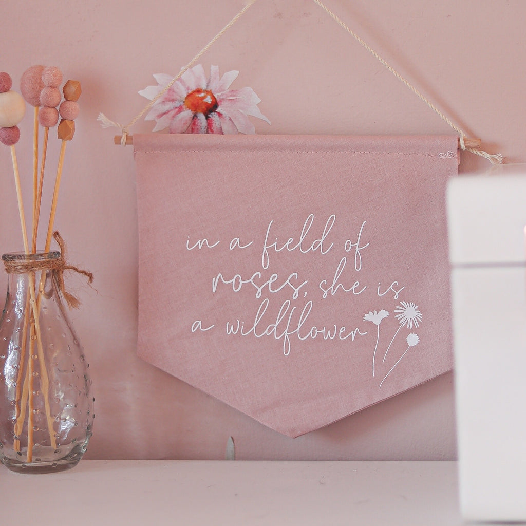 'In a field of roses, she is a wildflower' Fabric Banner - Ava & Harper co