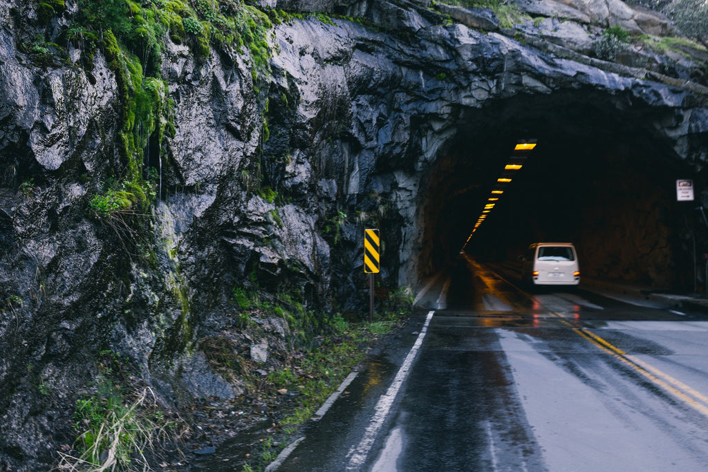 A van driving through a mountain tunnel.