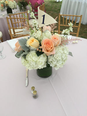 Pretty Wedding Centerpiece with Peach and Cream roses and White Hydrangea