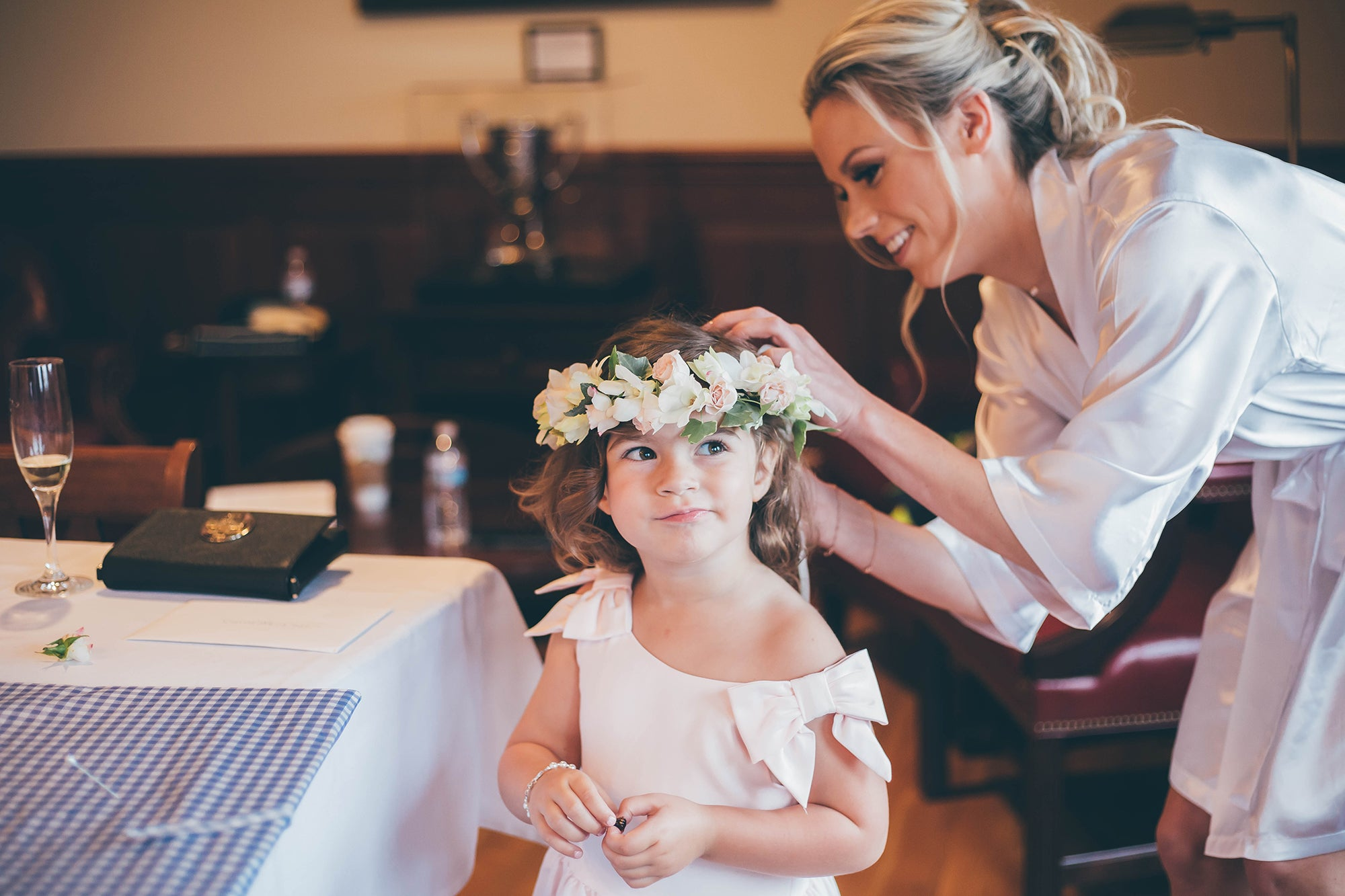 Bride helping Flower Girl with a Floral Crown