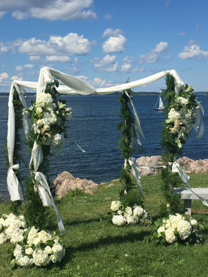 Seaside Chuppah with Large White Bouquets and Garland