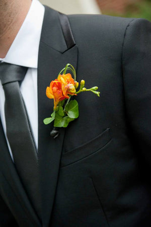 Peabody Essex Museum Bright Groom Boutonniere with Orange Freesia