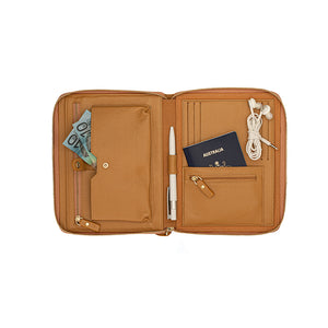 An opened pebbled leather travel wallet in camel with multiple pockets and credit card slots.