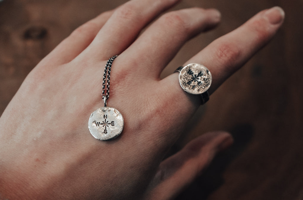 matching silver compass necklace and ring