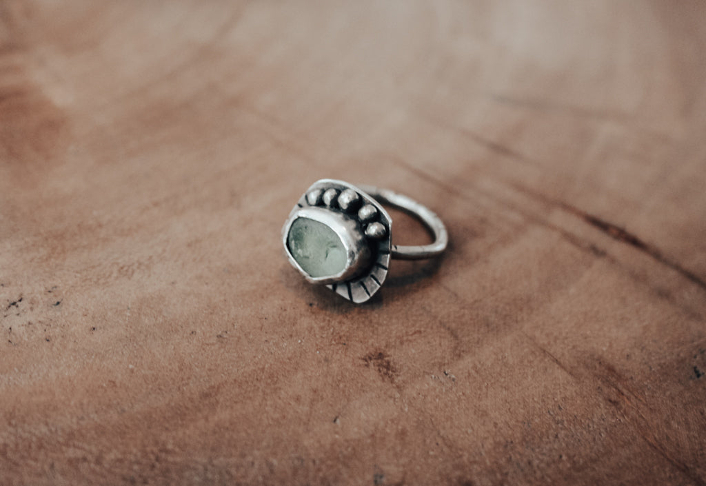 seafoam sea glass ring with silver orbs and stamped line details