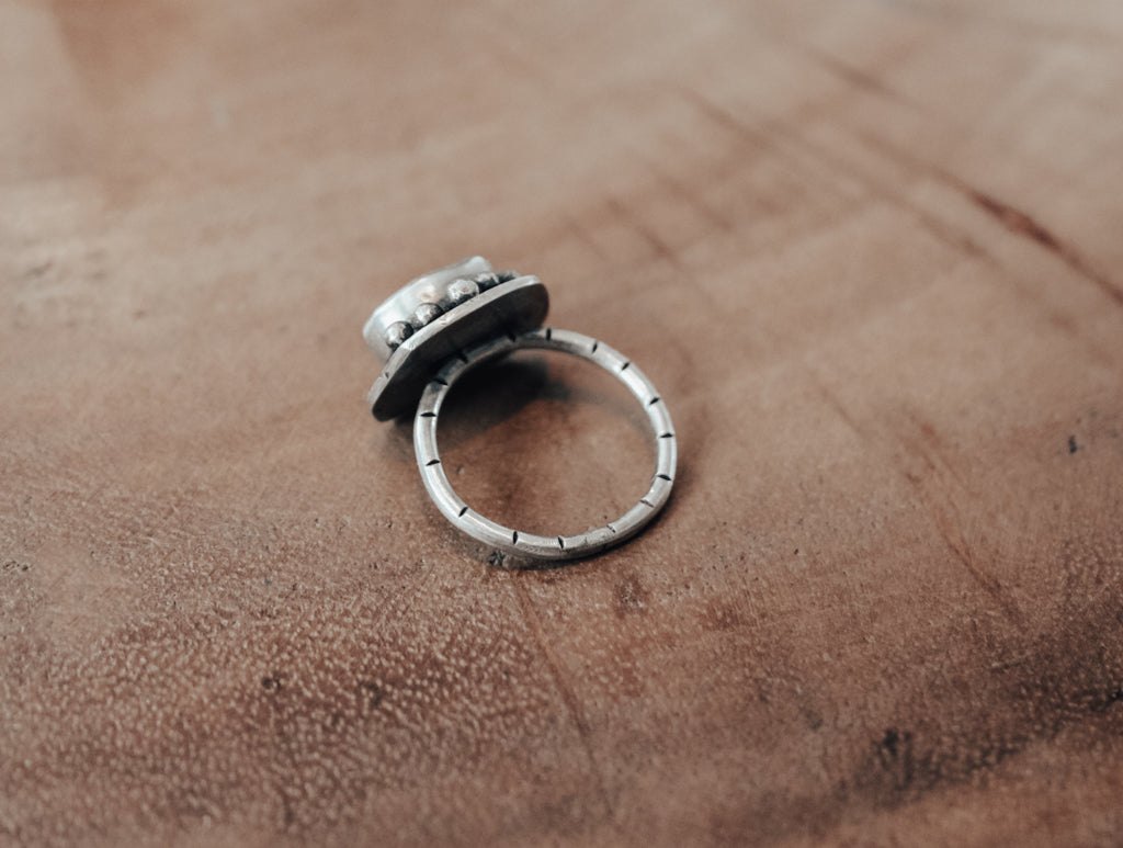 back of sea glass ring with notched ring band