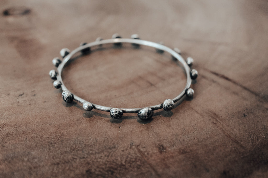 Organic silver bangle with large silver pebbles