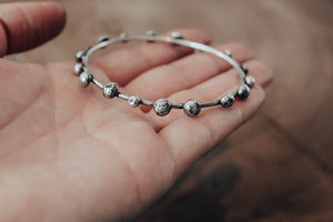 Textured silver pebbles on bangle