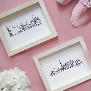Hand-printed city skyline on wood frame