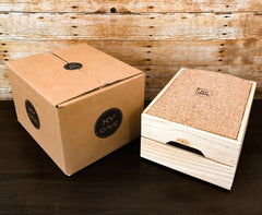 Wooden box with a cork lid on it with xy cave logo