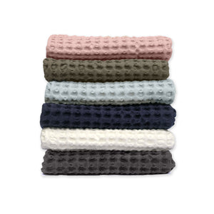 Luxury organic cotton hand towel from The Organic Company. Dark Blue, Natural White, Pale Rose Pink, Dark Grey