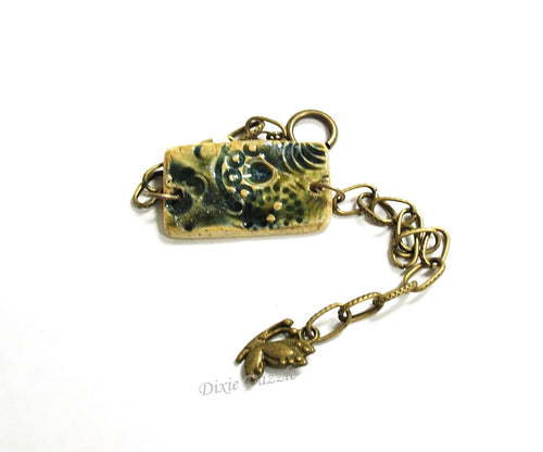 Textured ceramic bracelet, stoneware clay jewelry, olive green bracelet with butterfly charm
