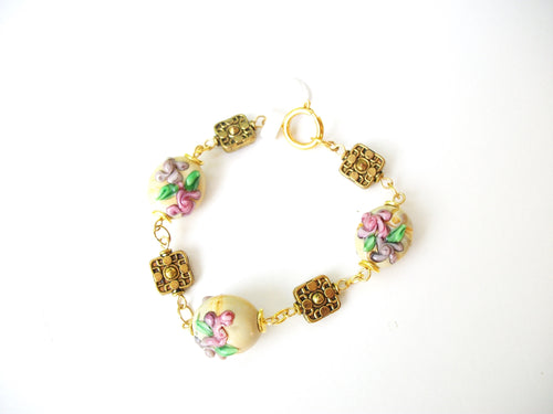Gold bracelet with lilac and mauve roses glass lampwork beads and textured gold beads