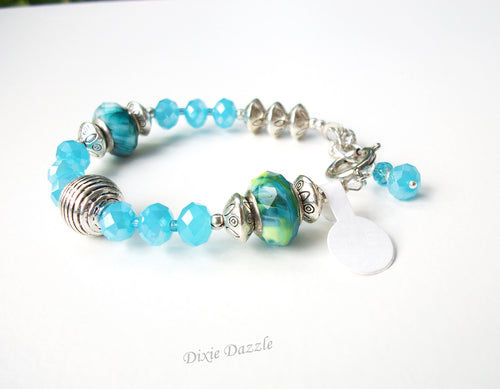 Beach jewelry, aqua blue crystal and Pandora style beaded bracelet. Adjustable length bracelet
