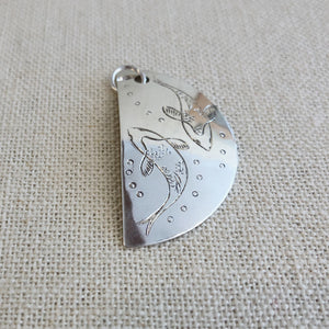 Engraved silver pendant