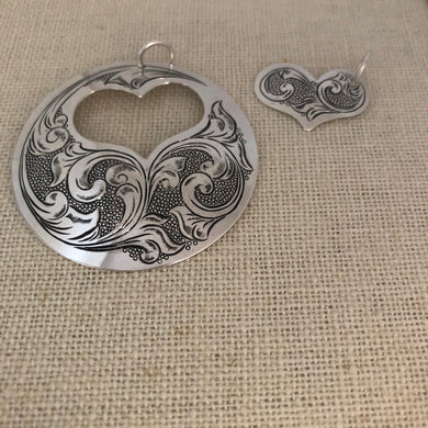 Engraved silver pendant, 2 pieces