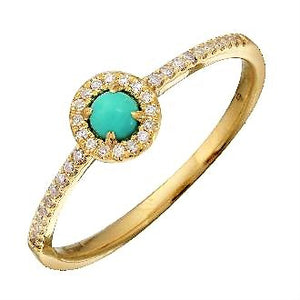 Diamond Halo Ring set with a Cabochon round Turquoise.