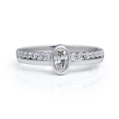 Bespoke engagement ring - oval Canadian diamond and 18ct recycled white gold