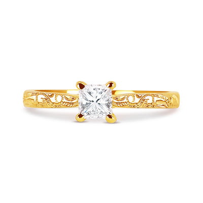 Bespoke engagement ring with hand-engraved Fairtrade Gold band and a princess-cut Canadian diamond 3