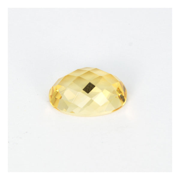 Yellow citrine, faceted cabuchon