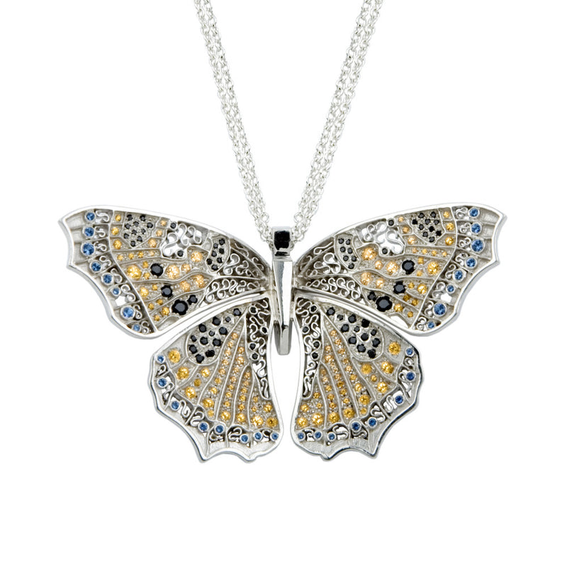 Bespoke Kites Hill butterfly pendant in collaboration with the World Land Trust and Liberty of London - sustainable silver and coloured Swarovski crystals