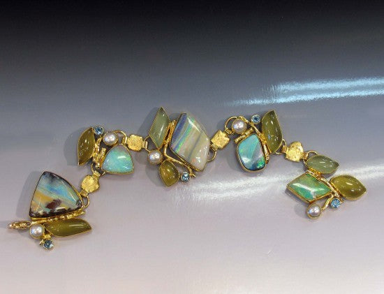 Boulder Opal Link Bracelet with Aquamarine, Topaz, and Pearl. 22k, 18k, 14k.