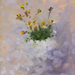 Multicoloured flowers in a white vase