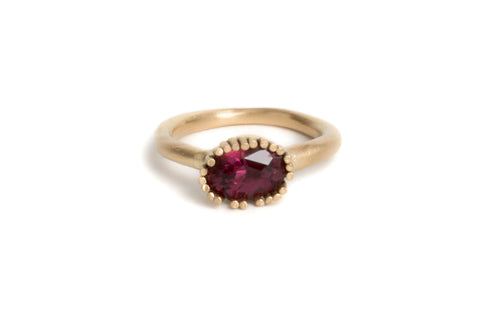 Engagement ring. 18ct yellow gold & garnet