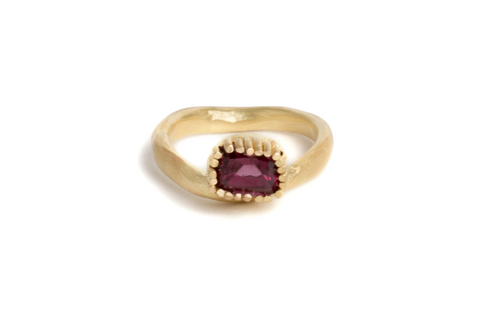 gold engagement ring with garnets
