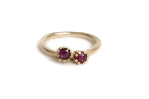 gold engagement ring with rubies