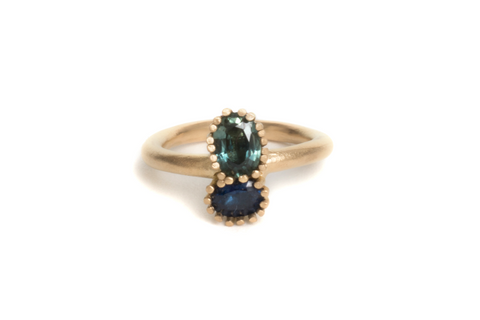 gold engagement ring with sapphires