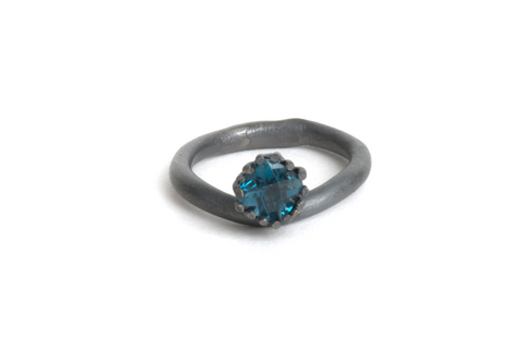 silver ring with london topaz