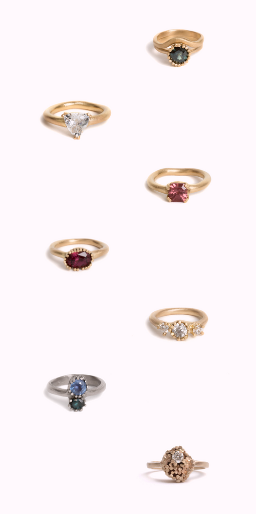assortment of gold engagement rings with various stones