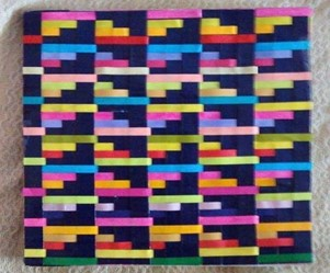 One of her first weaving project - A woven book cover made while in school | Muezart