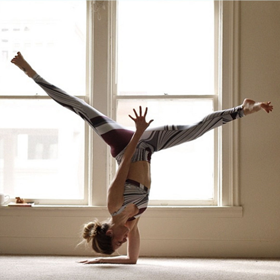one hand headstand
