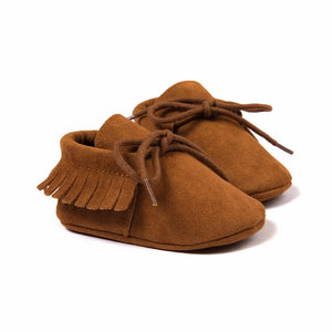 The Classic Suede Fringe Lace Up Moccasins