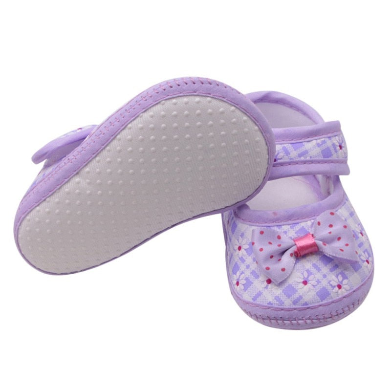 The Dotted Bow Soft Sole Strap On Shoes